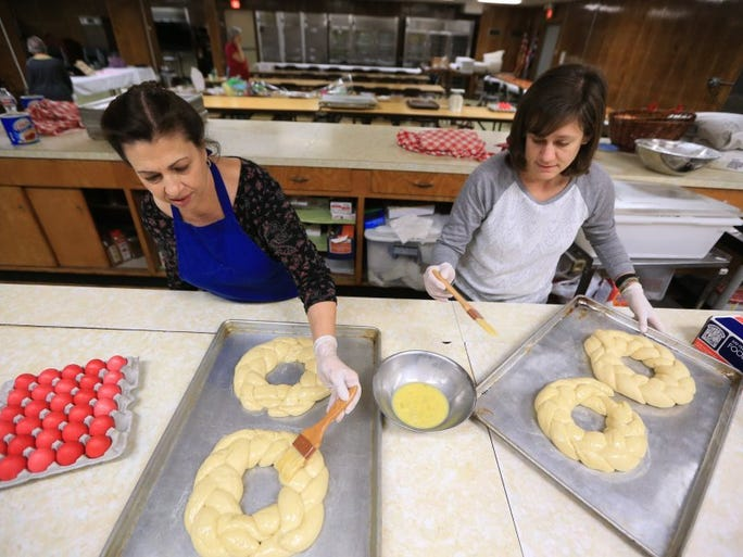 Rachel Denny Clow/Caller-Times Kandice Haby (left) and Helen Pool prepare bread for the annual Easter Bake Sale at the St. Nicholas Greek Orthodox Church on Monday, March 21, 2016. The sale is a tradition in Corpus Christi and typically sells out by noon Friday, organizers said.