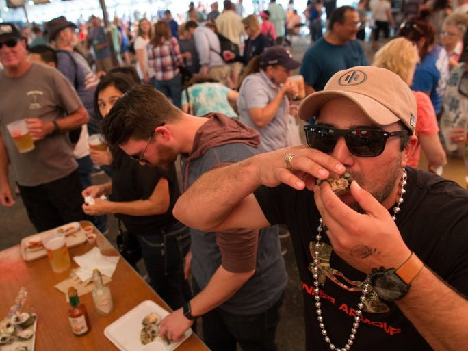 COURTNEY SACCO/CALLER-TIMES Jeremy Nicole shoots an oyster Saturday, March 5, 2016, during the 37th annual Fulton Oysterfest in Fulton.