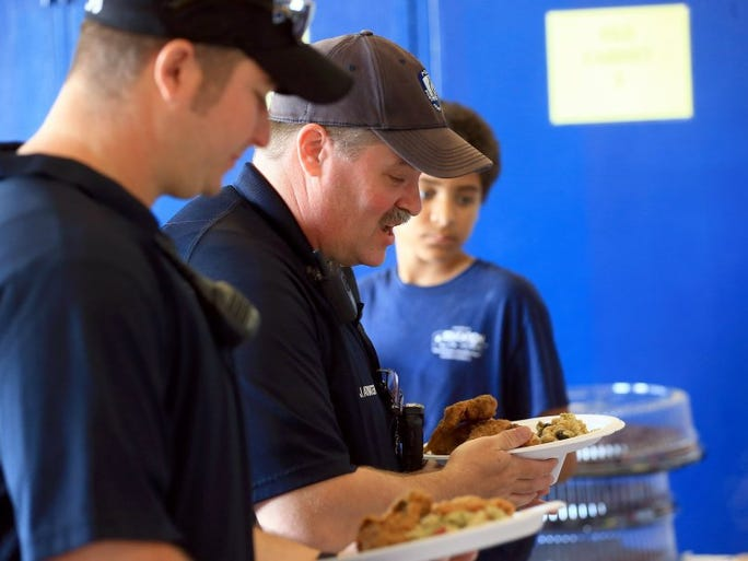 GABE HERNANDEZ/CALLER-TIMES Officer Jason Atwater serves a plate of warm food before heading out to the beach during spring break on Monday, March 14, 2016, at the Port Aransas Police Department.
