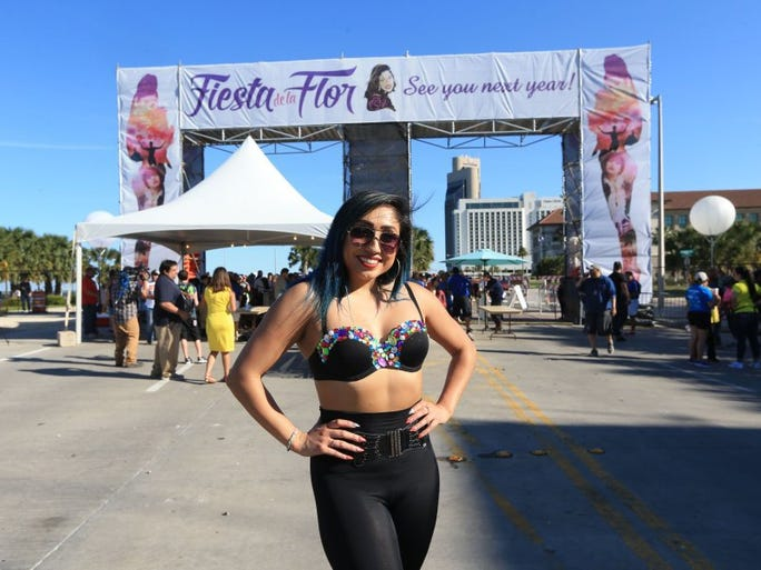 Chelsea Reyes sports a Selena outfit while attending the Fiesta de la Flor festival Friday, May 6, 2016.