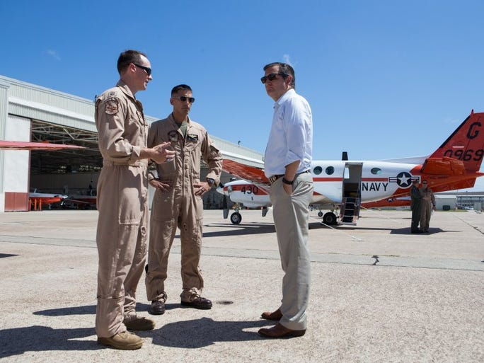 U.S. Sen. Ted Cruz, R-Texas, talks to members of the aviation community as he is shown training aircraft during a tour of Naval Air Station Corpus Christi on Thursday, Aug. 25, 2016.