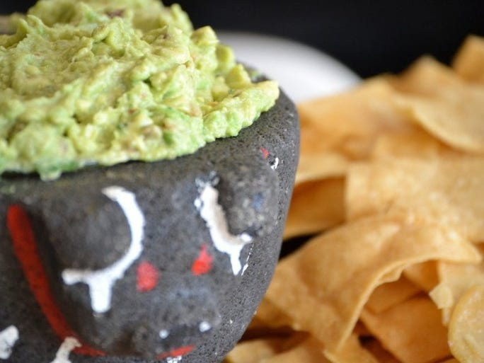 Guacamole is made table side at Babalu, 412 S. Gay Street.