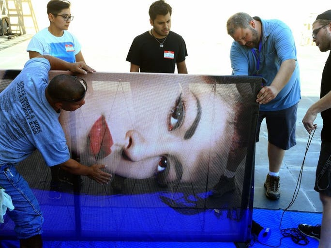 GABE HERNANDEZ/CALLER-TIMES Workers from the Production Resource Group prepare the entrance for the MAC Selena makeup collection launch Thursday, Sept. 29, 2016, at the American Bank Center in Corpus Christi.