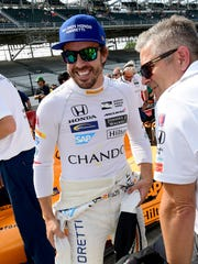 McLaren-Honda-Andretti IndyCar driver Fernando Alonso (29),left, and Gil de Ferran before his qualifying run for the Indianapolis 500 Friday, May 20, 2017, afternoon at the Indianapolis Motor Speedway.