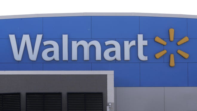 A Walmart logo is attached to the outside of a Walmart store, Tuesday, Sept. 3, 2019, in Walpole, Mass. Walmart is going back to its folksy hunting heritage and getting rid of anything that's not related to a hunting rifle after two mass shootings in its stores in one week left 24 people dead in August of 2019. (AP Photo/Steven Senne)