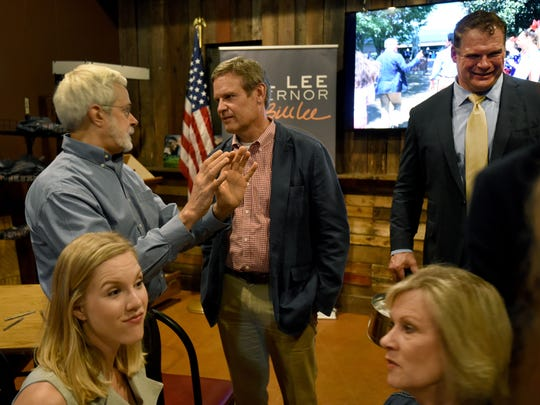 Gubernatorial candidate Bill Lee talks to supporters after a town hall meeting June 28, 2018, at SoKno Market in South Knoxville.