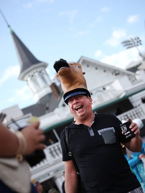 This man is supporting the new trend of wearing horse hats at the Kentucky Derby