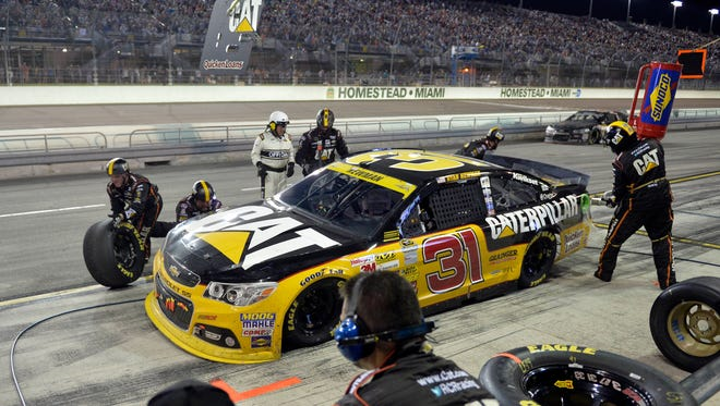 Teams will need to be cautious in the pits this year, as NASCAR will be scrutinizing every move. Here, a NASCAR  official monitors Ryan Newman's crew at Homestead-Miami Speedway.