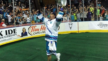 Irondequoit native Joe Walters, shown hoisting the NLL championship trophy at Blue Cross Arena after Rochester won its third straight title in 2014, signed a four-year contract with the team.