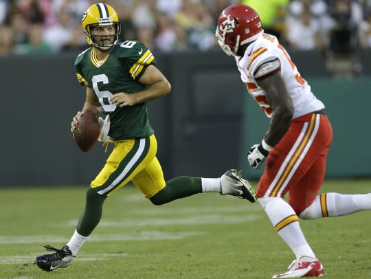 Green Bay Packers' Graham Harrell looks to pass against