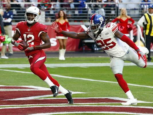 File-This Dec. 24, 2017, file photo shows Arizona Cardinals wide receiver John Brown (12) scoring a touchdown as New York Giants defensive back Brandon Dixon (25) defends during the second half of an NFL football game, in Glendale, Ariz.  The Baltimore Ravens provided quarterback Joe Flacco with two new potential targets Wednesday, March 14, 2018, agreeing to terms with wide receivers Ryan Grant and Brown on the first day of free agency. (AP Photo/Ross D. Franklin, File)