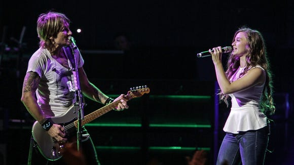 """Grace Aufderbeck, 17, of Bridgetown sang """"We Were Us"""" with Keith Urban on the Riverbend stage July 31."""