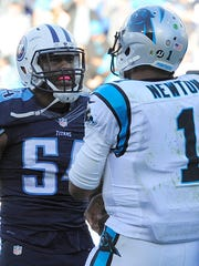 Panthers quarterback Cam Newton has words with Titans linebacker Avery Williamson after Newton's celebration dance in the end zone.