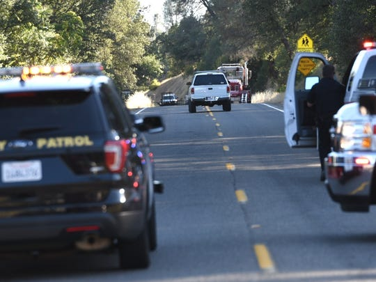 A white Dodge pickup is pursued by the California Highway