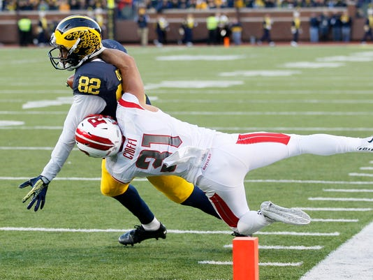 Michigan's Amara Darboh (82) is tackled short of the goal by Rutgers' Anthony Cioffi (31) during the first half of an NCAA college football game Saturday, Nov. 7, 2015, in Ann Arbor, Mich. (AP Photo/Duane Burleson)
