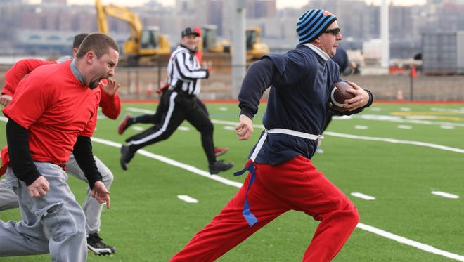 Mike Monroe of the Edgewater Police Department made this long catch to set up a touchdown for his team.