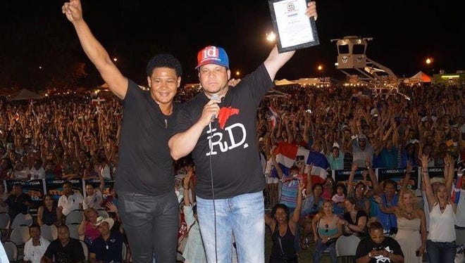 El Jeffrey (left), Irving Lozada and tens of thousands of their friends in Perth Amboy at last year's Perth Amboy Dominican Festival.
