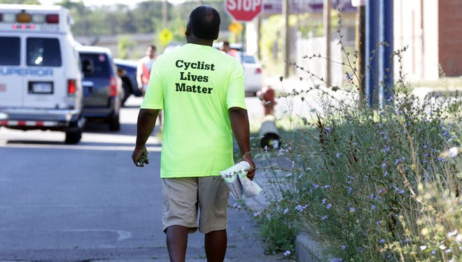 """A man wears a t-shit , """"Cyclist Lives Matters"""" at Neighborhood Service Organization's 17-mile NSO annual Handlebars For the Homeless tour of Detroit's neighborhoods Sunday, Aug. 7, 2016."""