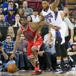 Chicago Bulls guard E'Twaun Moore (55) dribbles the basketball against Sacramento Kings forward Rudy Gay (8) in the third quarter at Sleep Train Arena. The Bulls defeated the Kings 107-102.