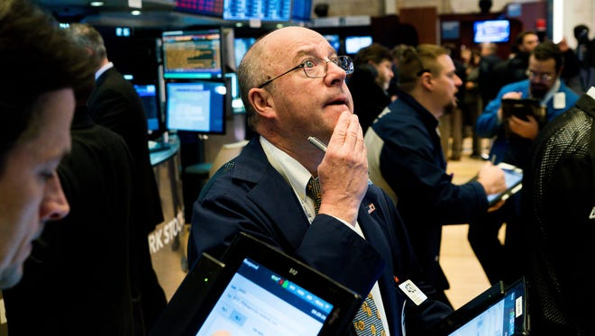 Traders work on the floor of the New York Stock Exchange at the Opening Bell in New York on February 9, 2018.