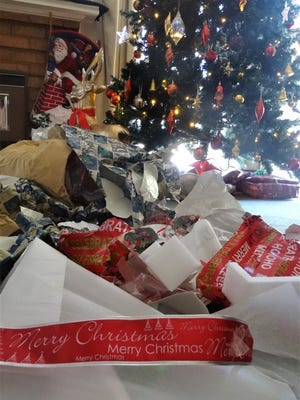 The potential aftermath of Christmas morning – lots of non-reusable wrapping paper and ribbons that may or may not end up in the recycling bin.