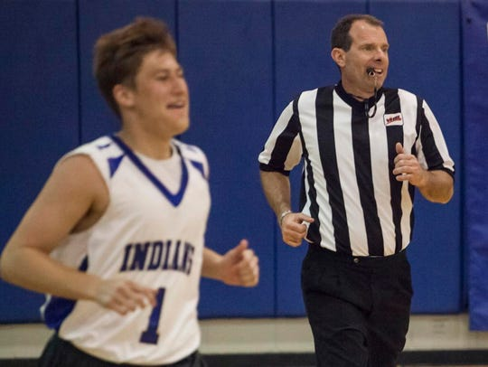 Mike Ruckman, who is fighting colon cancer, runs downcourt