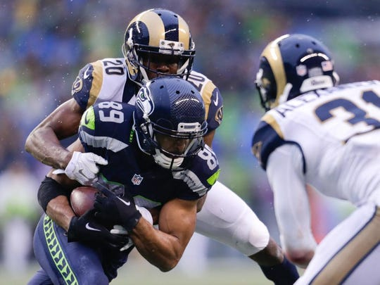 Seattle Seahawks' Doug Baldwin (89) is grabbed by St. Louis Rams' Lamarcus Joyner in the second half of an NFL football game, Sunday, Dec. 27, 2015, in Seattle. (AP Photo/John Froschauer)