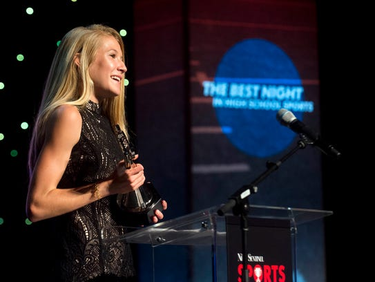 Rebecca Story accepts the Athlete of the Year award