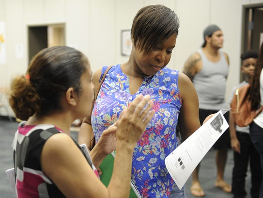Parent Erika Rudolph is helped by Metro Schools enrollment