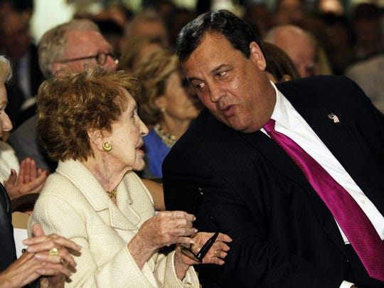 New Jersey Gov. Chris Christie, right, chats with former first lady Nancy Reagan at the Ronald Reagan Presidential Library in Simi Valley, Calif.,Tuesday, Sept. 27, 2011. Gov. Christie warned Tuesday that America's promise is being menaced from within, as a troubled U.S. economy, shaky leadership and political gridlock diminish the nation's ability to solve its problems.
