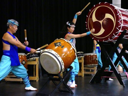 Members of the Matsuriza Taiko Drummers perform at