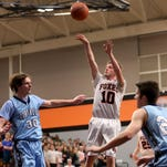 Silverton's Blake Cosgrove (13) stretches for the basket in the Corvallis vs. Silverton boy's basketball game at Silverton High School in Silverton, Ore., on Wednesday, Feb. 10, 2016.