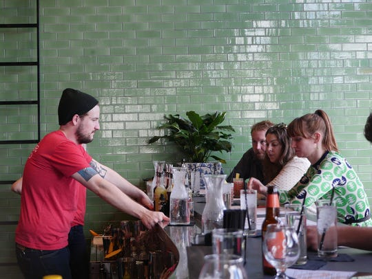 Bartender Alex Kirles, 24, waits on diners at the Peterboro