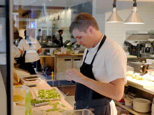 Executive Chef Nick Janutol works in the glass-enclosed kitchen at Forest in Birmingham.