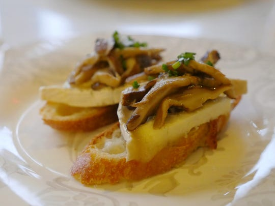 Montadito de Setas is rustic bread topped with olive-oil poached shiitake mushrooms with aged goat cheese and chives. The restaurant La Dulce in Royal Oak.