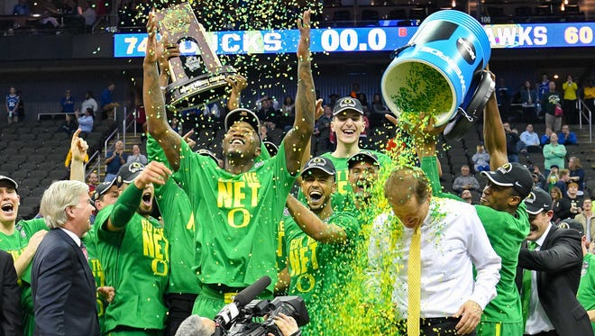 Oregon Ducks head coach Dana Altman is doused by confetti by his players as they celebrate with the trophy after the game against the Kansas Jayhawks in the finals of the Midwest Regional of the 2017 NCAA Tournament at Sprint Center. Oregon defeated Kansas 74-60.