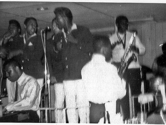Clarence Clemons, with saxophone, backing the Broadways in Asbury Park in 1964. This picture, from the collection of Ronald Coleman, is shown at the Asbury Park Museum.