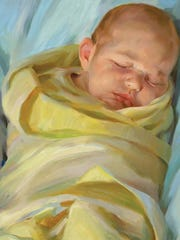 """Tyler Klemme was just three days old when he sat (or napped) for Rose Frantzen's """"Portrait of Maquoketa."""""""