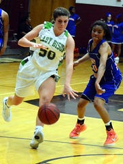 Station Camp High sophomore Sydney Creager dribbles past Hunters Lane's Michilina McClain during fourth-quarter action. Creager scored five points in Station Camp's 68-36 victory.