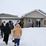 People arrive for the block party home dedications on Jan. 19.