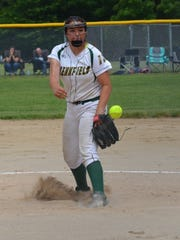 Pennfield's Katie Lenz throws home during this district