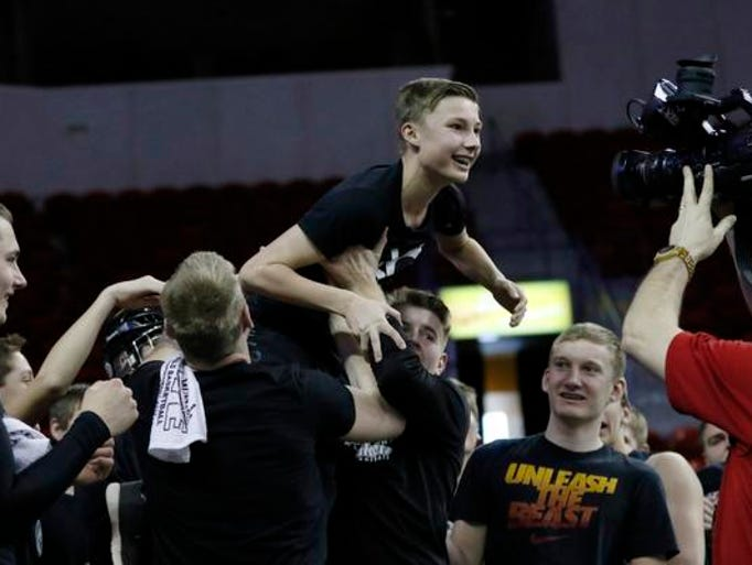 A Loyal High School fan crowd surfs for the cameras