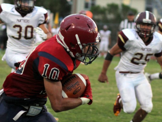 "Junior Tony ""P.J."" Mariscall III (10) had touchdown receptions of 54 and 70 yards during Deming's 36-31 win at Silver High on Friday."