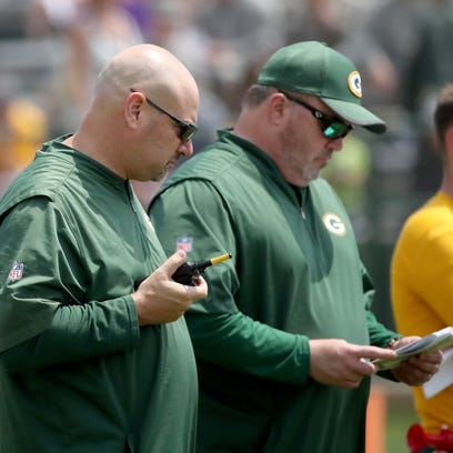 Head coach Mike McCarthy and defensive coordinator