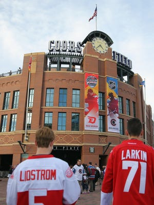 Wings fans arrive for Saturday night's game against the Avalanche at Coors Field.