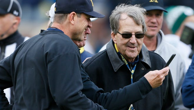 Former South Carolina coach Steve Spurrie, center gets a selfie with Michigan head coach Jim Harbaugh and former head coach Lloyd Carr before the Michigan State game  on Saturday, October 17, 2015, in Ann Arbor. Julian H. Gonzalez/Detroit Free Press