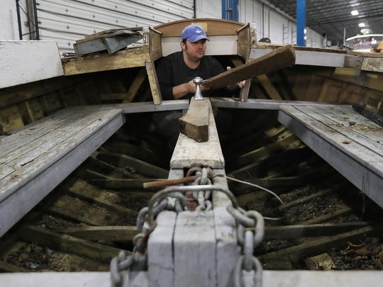 Mark Hawkins clears pieces of wood from a Mackinaw