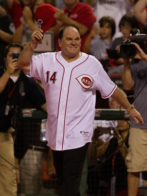 Pete Rose takes the field after the Reds 3-2 win over the Los Angeles Dodgers in Sept. 2013 at Great American Ball Park.