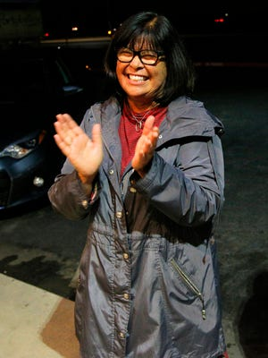 Amy Ish enjoys the news of her election night victory outside Portobello's in Salinas.
