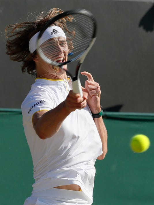 Germany's Alexander Zverev returns to Austria's Sebastian Ofner during their Men's Singles Match on day six at the Wimbledon Tennis Championships in London Saturday, July 8, 2017. (AP Photo/Kirsty Wigglesworth)
